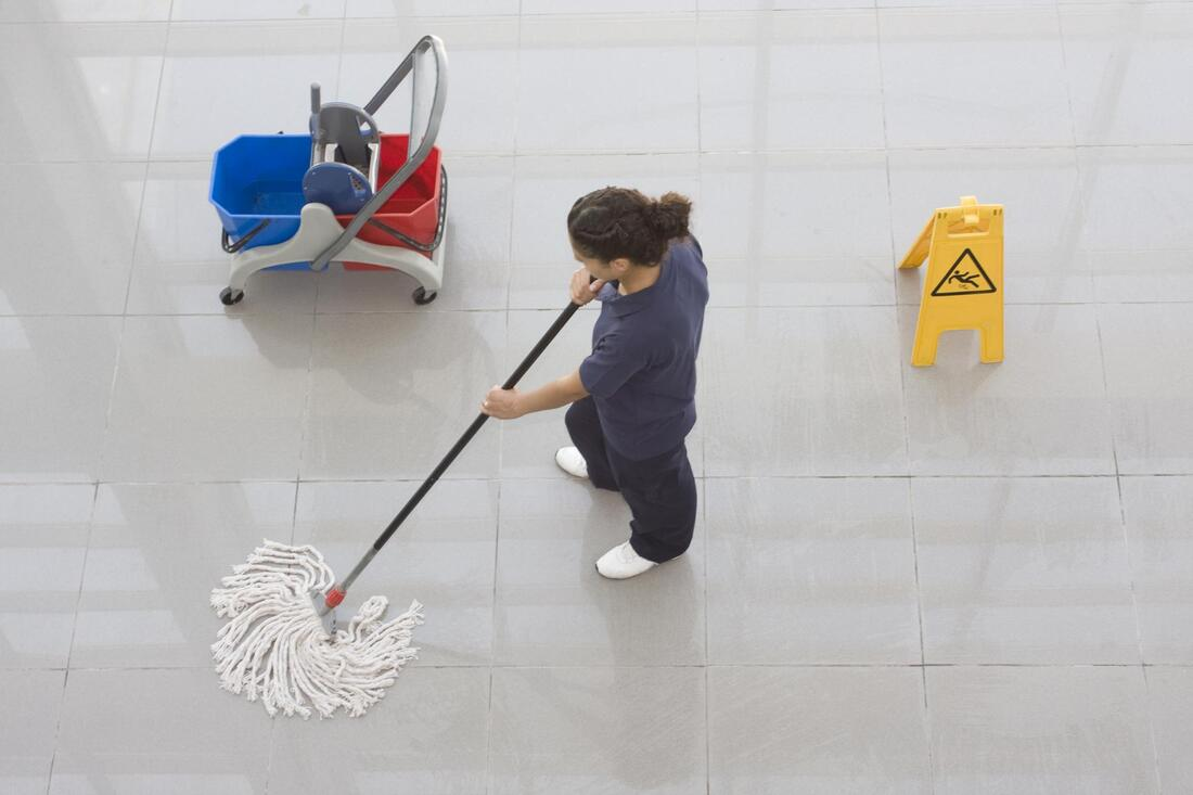 commercial cleaner doing business cleaning