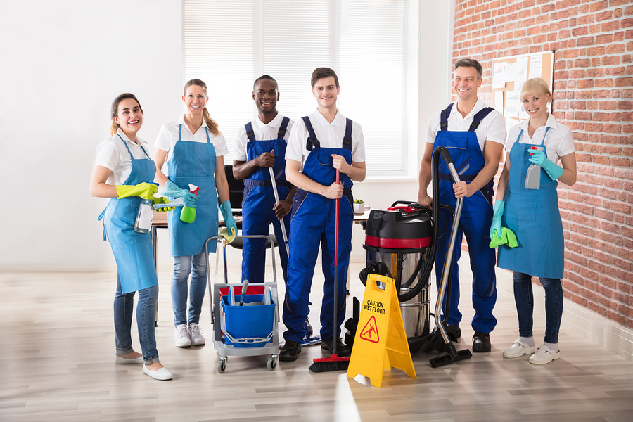 house cleaners team smiling